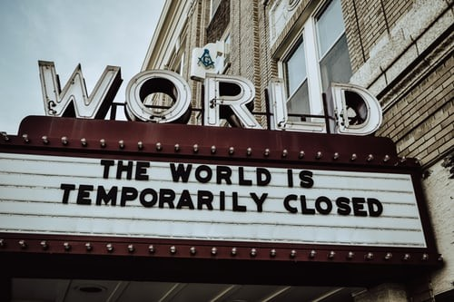 Sign reading 'the world is temporarily closed'